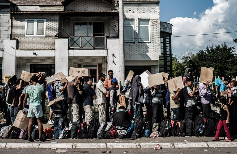 refugees-waiting-for-papers-to-be-processed