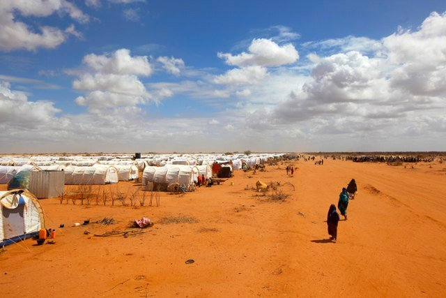 Somali refugees walk along the perimeter of Dadaab, a complex of refugee camps in Kenya, 60 miles (100km) from the Somali border. (AP/Jerome Delay)