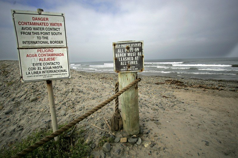 Signs warn beachgoers of contaminated water at Imperial Beach, Calif., south of San Diego, Wed., May 25, 2005. The beach, which runs from the city of Imperial Beach to the U.S.–Mexico border, was ranked as one of the two most polluted in California by the nonprofit organization Heal the Bay. (Lenny Ignelzi, AP)