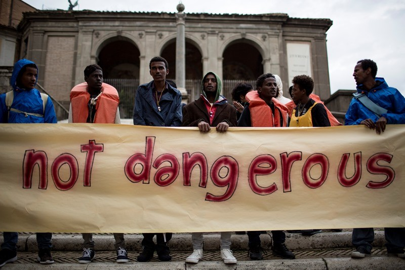 Asylum seekers hold a banner during a demonstration in central Rome calling for shelter and protection. (Christian Minelli/NurPhoto)