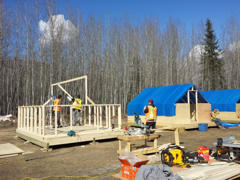 Farm students build their own wall-tent frame living quarters, complete with a bed, desk and electrical hook-ups. (Photo courtesy of Tr'ondëk Hwëch'in)