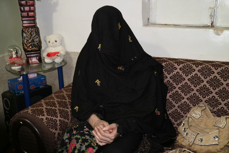 Gulalai, 25, a transgender Afghan living in Pakistan, covers her face to protect her identity. (Umer Ali)