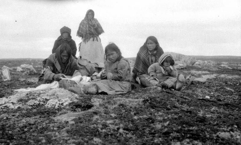 Inuit from Schultz Lake rest while en route to hunt caribou at the Thelon Game Sanctuary, in what is now Nunavut, in 1930. (W.H.B. Hoare/Canada. Dept. of Indian and Northern Affairs/Library and Archives Canada/PA-102646)