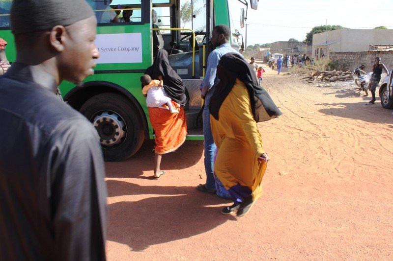 Buses dispatched by the Gambian government arrive at the refugee camp in Karang, Senegal; 70 percent of the returnees were women and children, according to HelpGambia volunteers. (Sanna Camara)