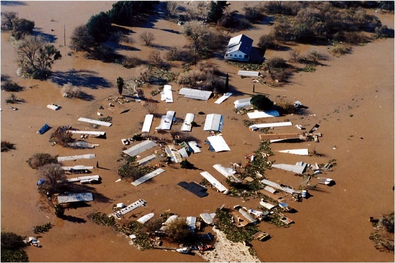 This mobile home park in Mossdale, on the edge of the Sacramento-San Joaquin Delta, was flooded by storms in 1997. Because of events like this, we tend to view muddy water as a bad thing. But muddy rivers are an essential natural process that we need to embrace. (Photo Courtesy Calif. Dept. fo Water Resources)