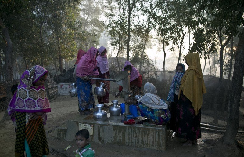 Refugees fetch water in Kutapalong.