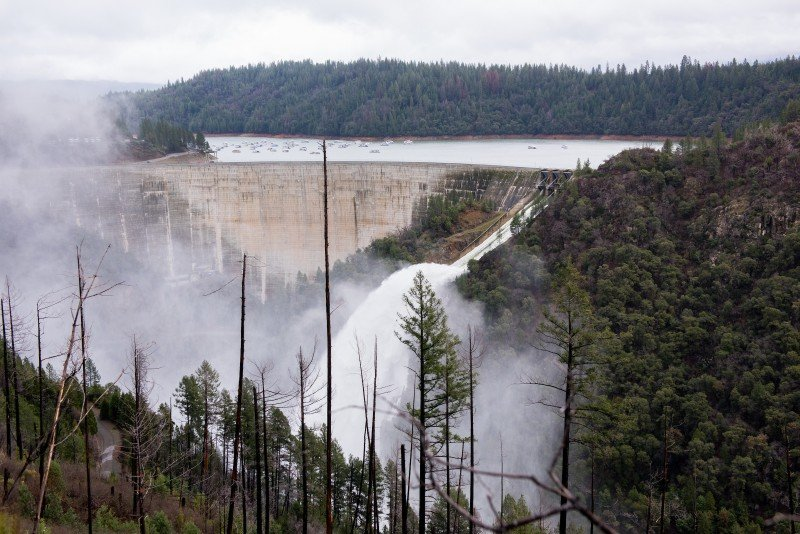 New Bullards Bar Reservoir in Yuba County releases water into the Yuba River during the atmospheric river event across Northern California Jan. 9, 2017. Despite a wet winter, California's water board voted Feb. 8, 2017, to extend conservation regulations. (Kelly M. Grow/California Department of Water Resources)