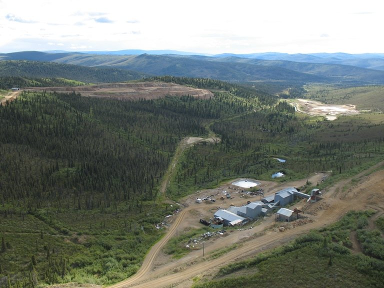 The abandoned Mt. Nansen mine in August 2008. When Toronto junior mining company BYG walked away from Mt. Nansen in 1999, they left left behind hundreds of thousands of cubic meters of waste and contaminated soil and a compromised tailings dam leaching cyanide and arsenic. (Photo Courtesy Government of Yukon)