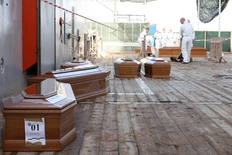 Twelve coffins on the deck of the supply ship Siem Pilot. Inside them are three children and nine adults who took the risk of getting into a fragile and overloaded rubber dinghy on shore in Libya. (Siem Pilot)