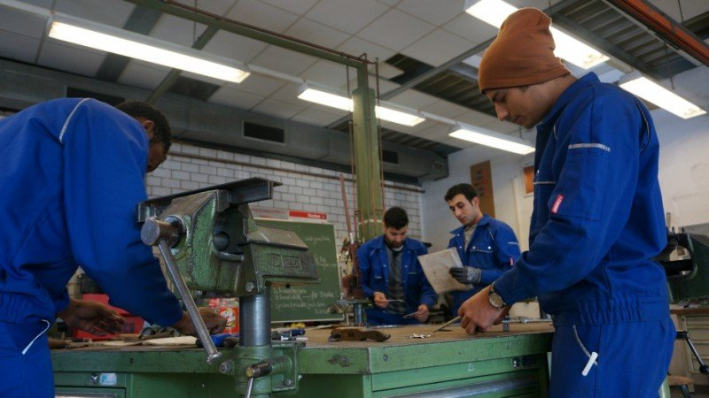 At the Cottbus Chamber of Crafts, trainees enrolled in a refugee training program prepare for the day's metalworking assignment, in Cottbus, Brandenburg, Germany, Jan. 11, 2017. (Austin Davis/PRI)