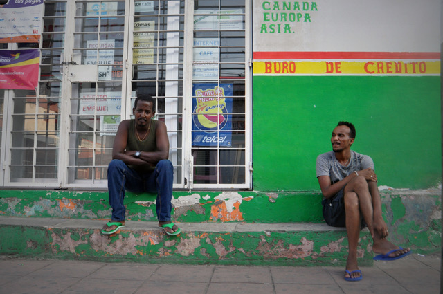 Merhaini and Mehani, migrants from Eritrea, sit in a street in Tapachula in December 2016. (Irene Savio)