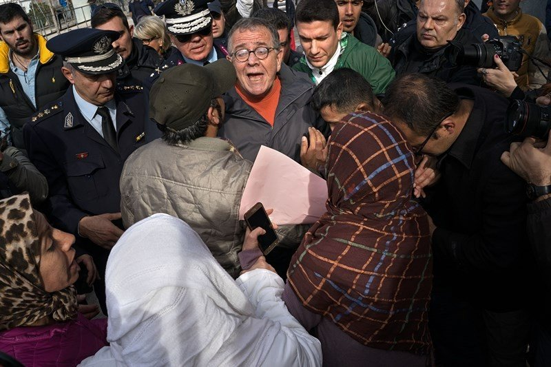 Greece's migration minister Ioannis Mouzalas is mobbed by furious refugees outside the Elliniko camp in Athens. (Nikos Pilos)