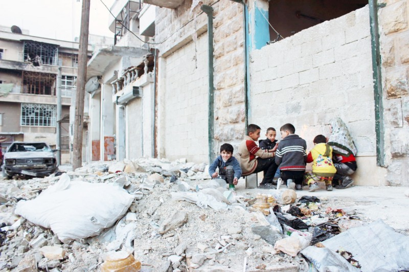 """A still from the HBO Documentary """"Cries From Syria"""" showing children playing in the rubble of a building in Syria. (HBO Documentary/ Cries From Syria)"""
