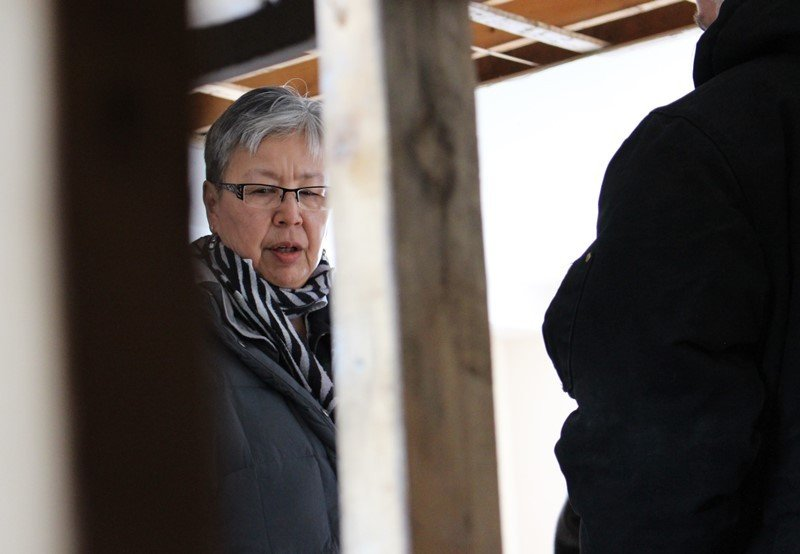 Sen. Lillian Dyck, chair of the Standing Senate Committee on Aboriginal Peoples, surveys a house in Iqaluit, Nunavut. (The Senate of Canada)