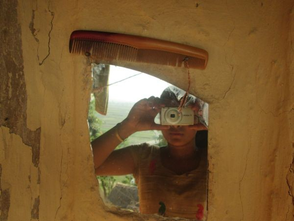 """This is a picture of the mirror and comb I use at my house. In our society, when girls experience their first menstruation, we are not allowed to look into mirrors or comb our hair. I think that is a wrong belief that we have in our society. My family does not follow this practice. But many of my friends' families are really strict, so they aren't allowed to look at themselves in the mirror and comb their hair. If my friends could grow up in an environment where there are no limitations during menstruation and receive more support from their families, they could feel free and have more opportunities."" (WaterAid/Sushma Diyali)"