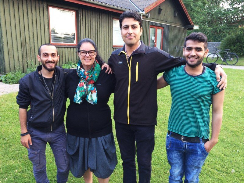 Olsen with Syrian refugees after an evening volunteer session. (Sonia Narang)