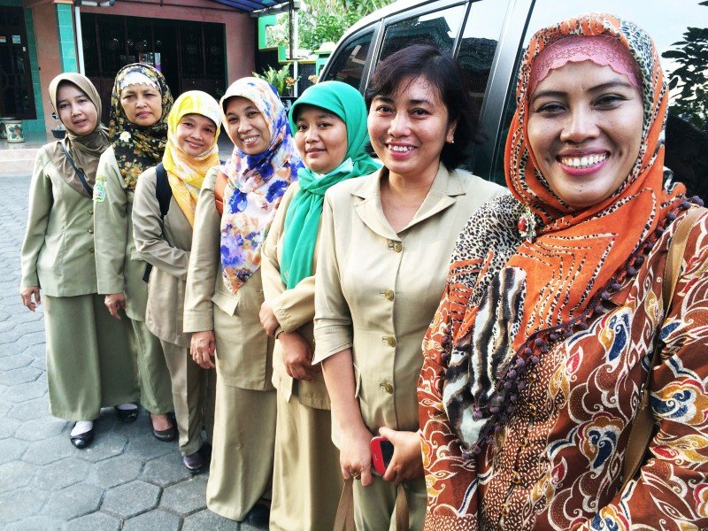These midwives in Wonosari, in central Indonesia, are the local eyes and ears on the ground. They keep track of how women are doing during and after pregnancy, and offer family planning services. (Sonia Narang)