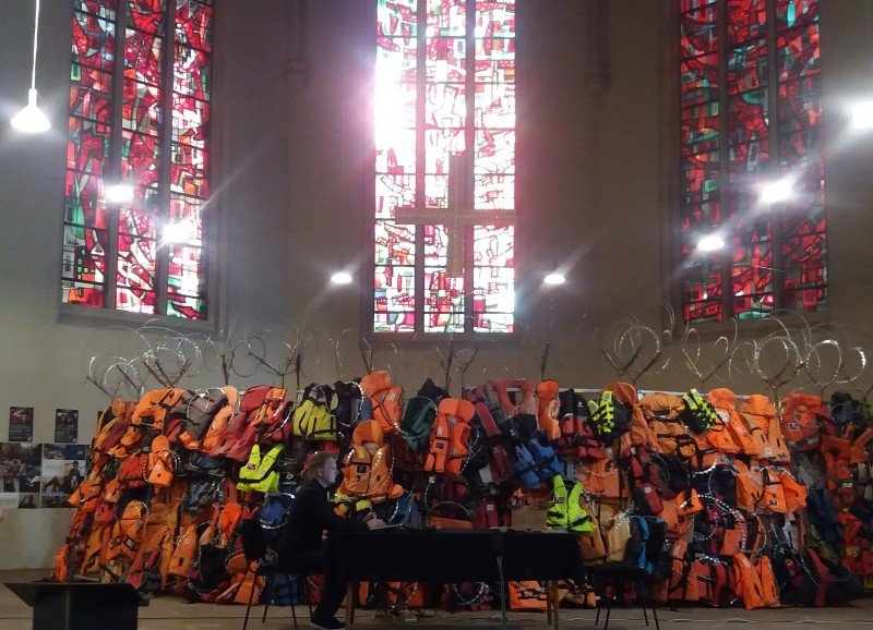 The exhibit A Wall of Life Jackets and Their Stories, which collected lifejackets left behind by refugees who reached Greece. The 10-meter-long wall was on display at a Lutheran church in Saarbrucken from mid-July to the end of August. (Sandra Prufer)