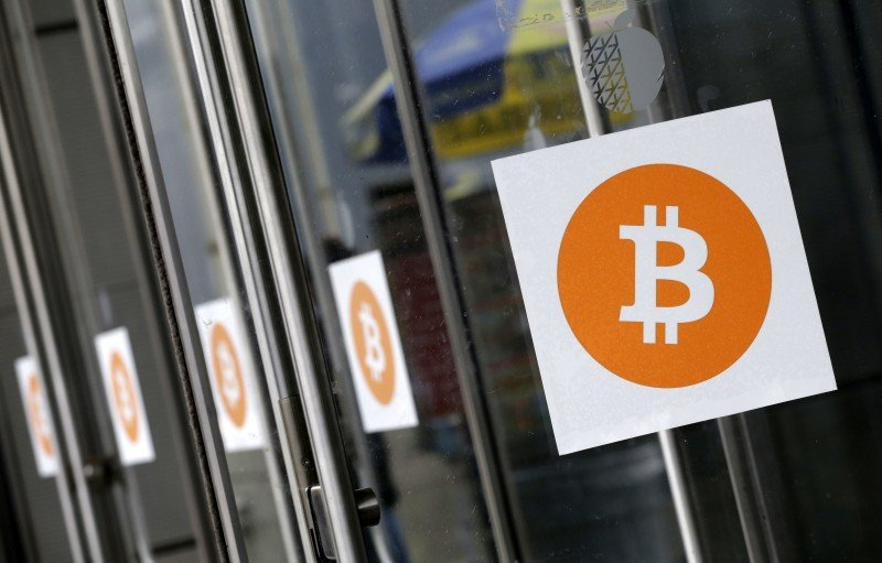 Bitcoin is a digital currency invented by an unidentified group of computer programmers in 2008. An NGO in Zimbabwe now hopes to use it to help female farmers overcome drought. (AP/Mark Lennihan)