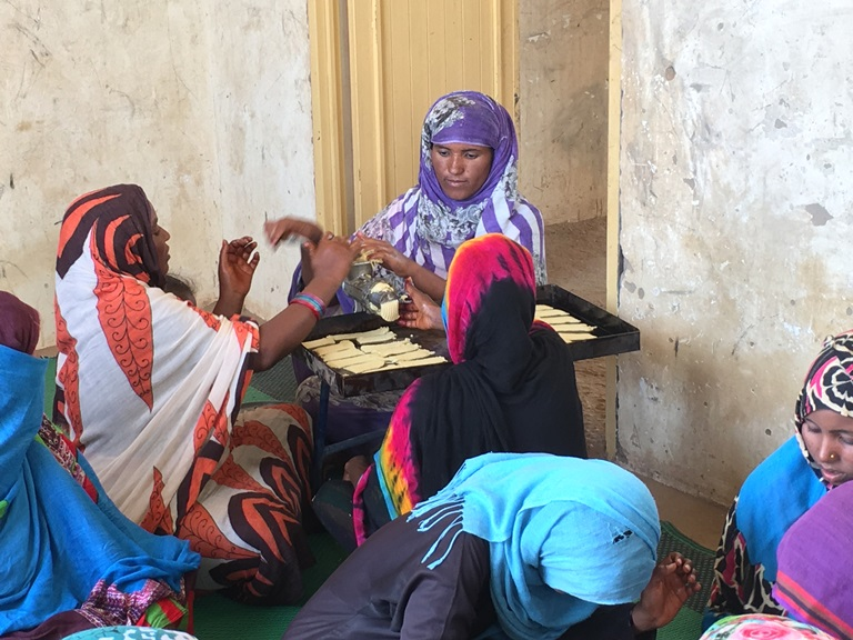 Women in desert villages in Sudan's River Nile state are being taught how to bake and make dairy products to diversify local economies that rely on agriculture. (Hannah McNeish)